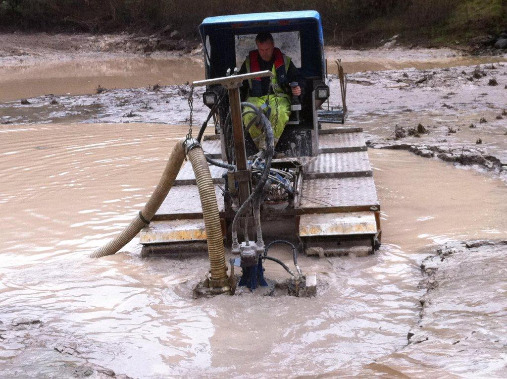 Truxor amphibious vehicle removing silt, dredging, silt pumping